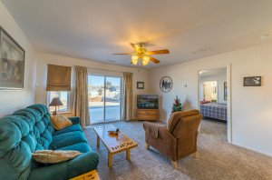 Living Room with Ceiling Fan - 1732 Pioneer Circle Delta, CO 81416 - Atha Team Real Estate