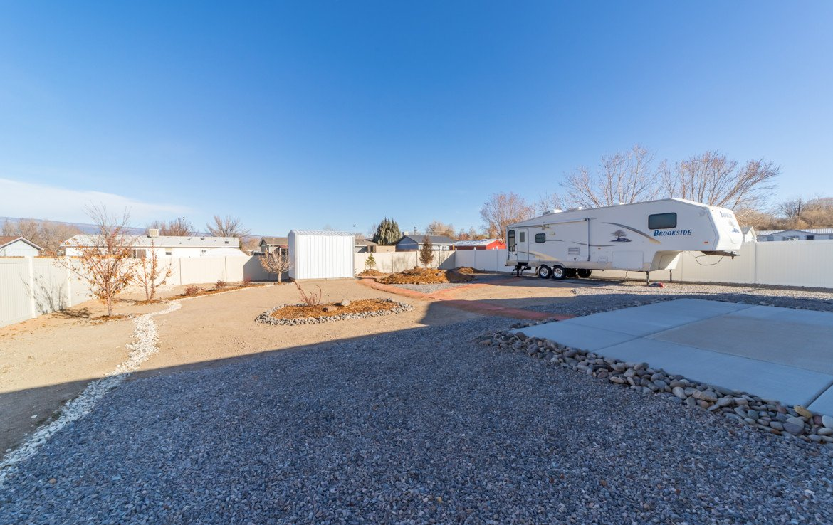 Back Yard with RV Storage - 1732 Pioneer Circle Delta, CO 81416 - Atha Team Real Estate