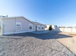 Rear of Home with Back Patio - 1732 Pioneer Circle Delta, CO 81416 - Atha Team Real Estate