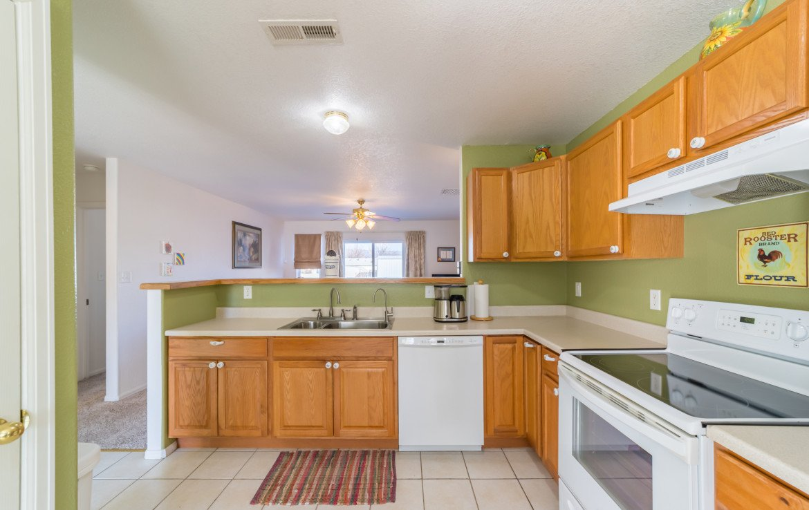 Kitchen with Tile Flooring - 1732 Pioneer Circle Delta, CO 81416 - Atha Team Real Estate