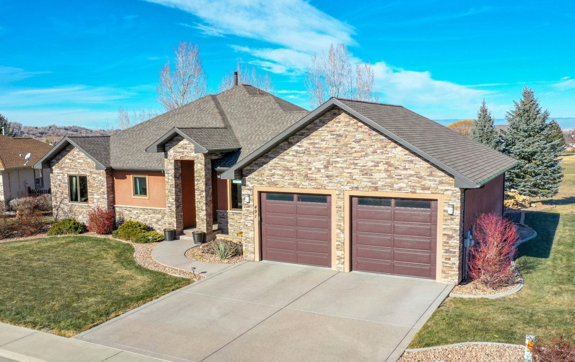 3 Car Attached Garage - 491 Collins Way Montrose, CO 81403 - Atha Team Listing