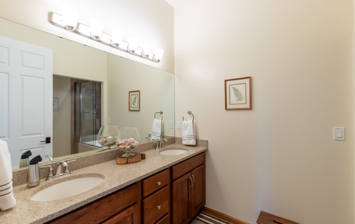 Guest Bathroom with Dual Sinks - 491 Collins Way Montrose, CO 81403 - Atha Team Listing