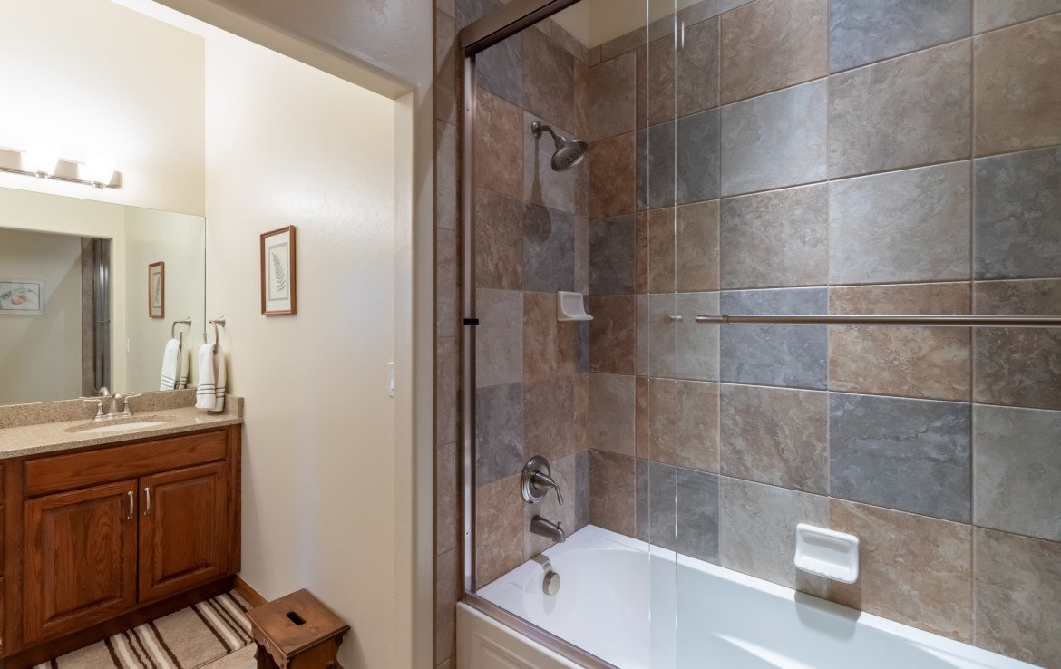 Guest Bathroom with Tiled Shower - 491 Collins Way Montrose, CO 81403 - Atha Team Listing