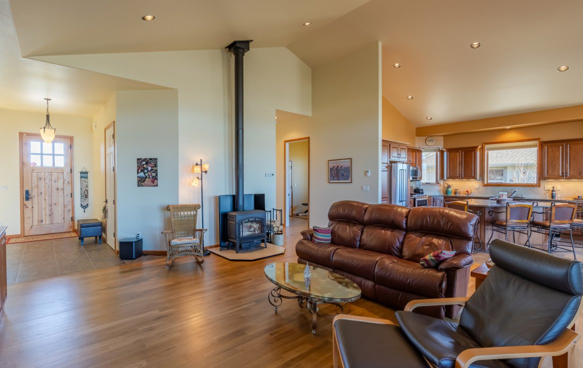 Living Room with Wood Burning Fireplace - 491 Collins Way Montrose, CO 81403 - Atha Team Listing