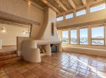 Living Room with Adobe Fireplaces - 23740 7010 Rd Montrose, CO 81403 - Atha Team Realty