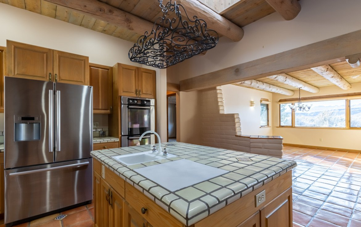 Kitchen with Center Island - 23740 7010 Rd Montrose, CO 81403 - Atha Team Realty