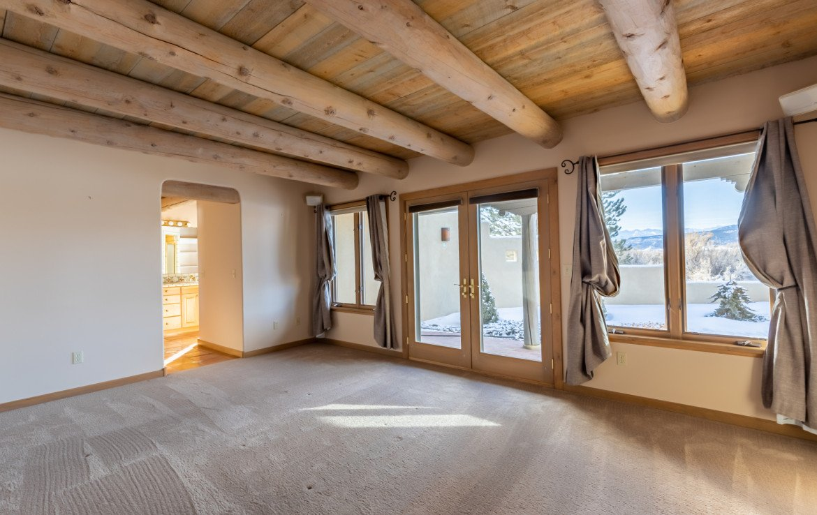 Bedroom with Walk Out Patio Access - 23740 7010 Rd Montrose, CO 81403 - Atha Team Realty