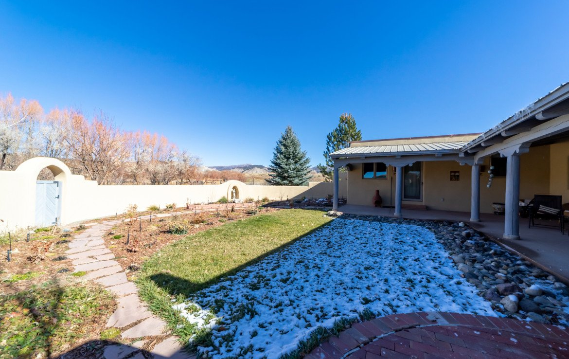 Back Yard Courtyard with Adobe Fencing - 23740 7010 Rd Montrose, CO 81403 - Atha Team Realty