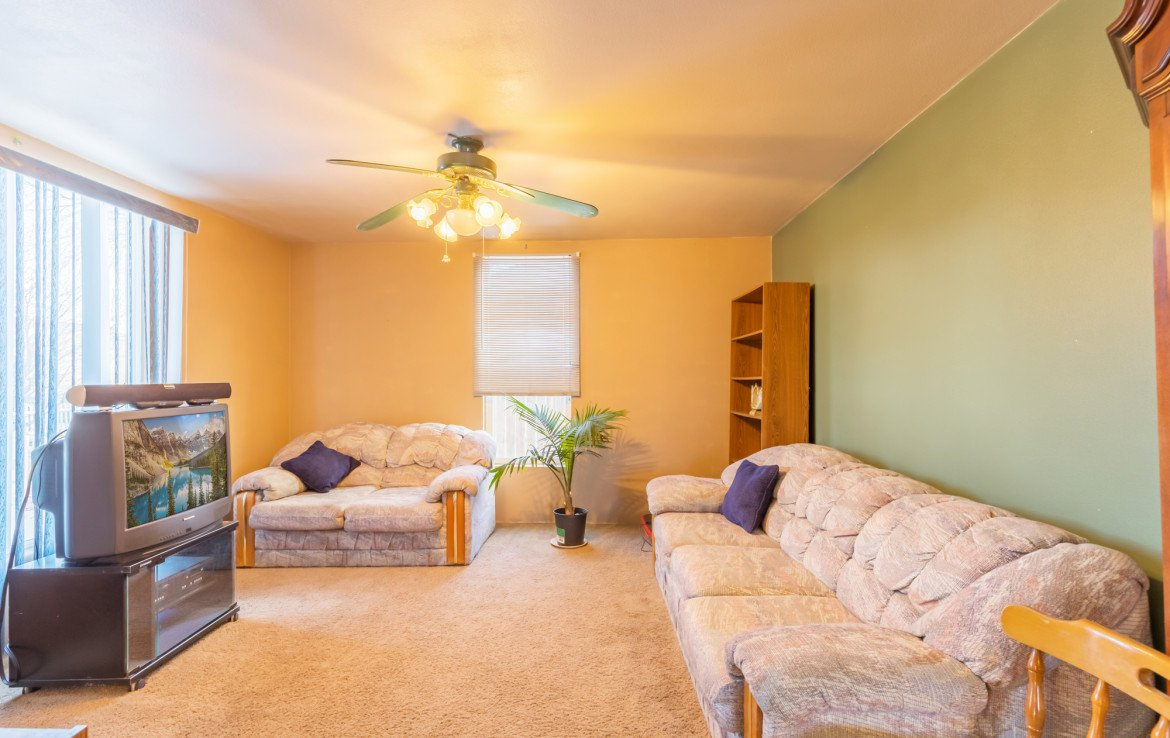 Living Room with Ceiling Fan - 54 W. South 3rd St Montrose, CO 81401 - Atha Team Real Estate Listing