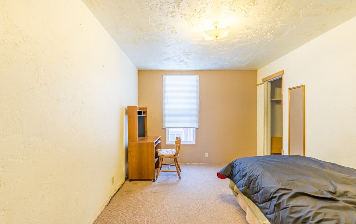 Second Bedroom - 54 W. South 3rd St Montrose, CO 81401 - Atha Team Real Estate Listing