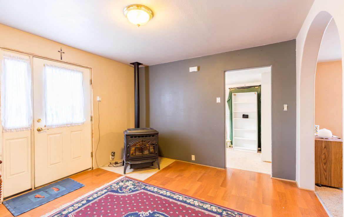 Entry Way with Pellet Stove - 54 W. South 3rd St Montrose, CO 81401 - Atha Team Real Estate Listing