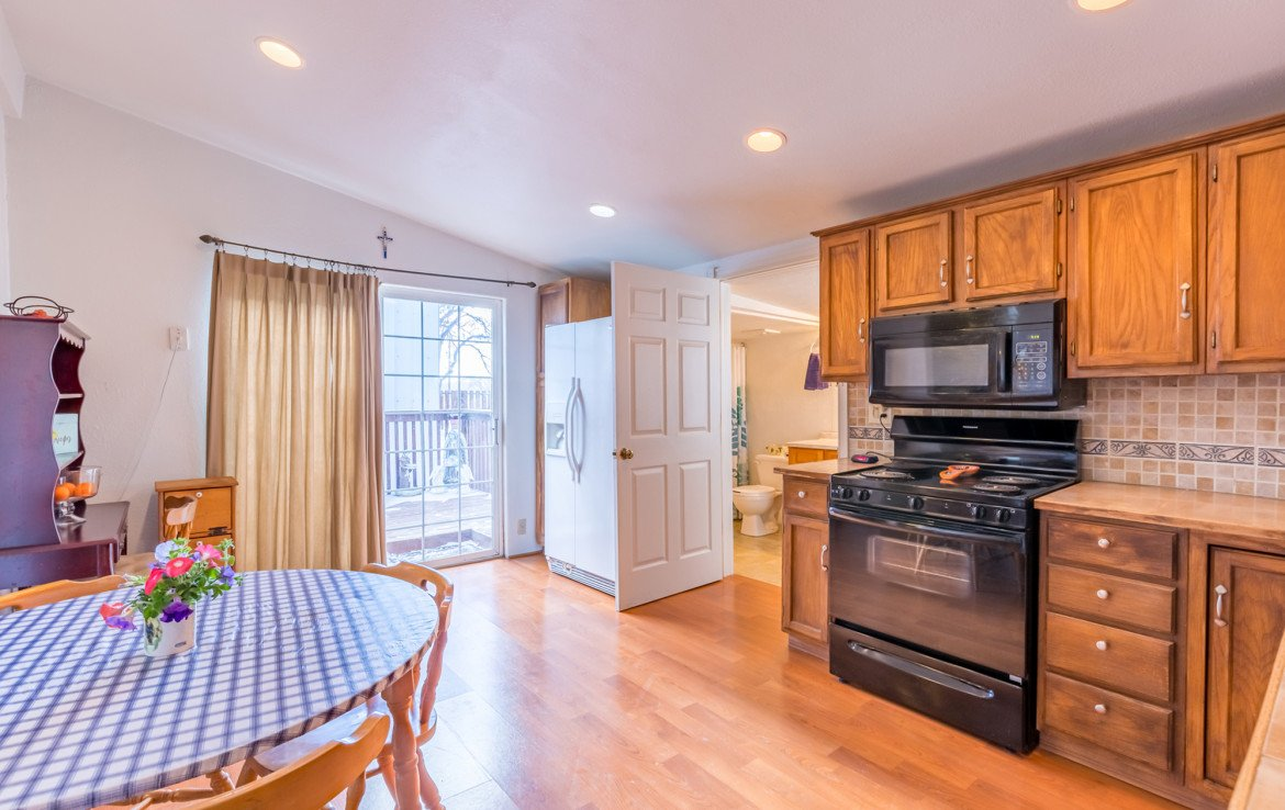Kitchen with Back Yard Access - 54 W. South 3rd St Montrose, CO 81401 - Atha Team Real Estate Listing