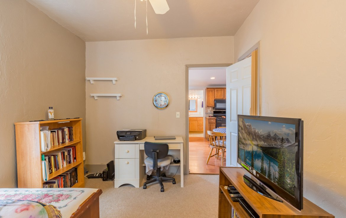 Bedroom with Carpeting - 54 W. South 3rd St Montrose, CO 81401 - Atha Team Real Estate Listing