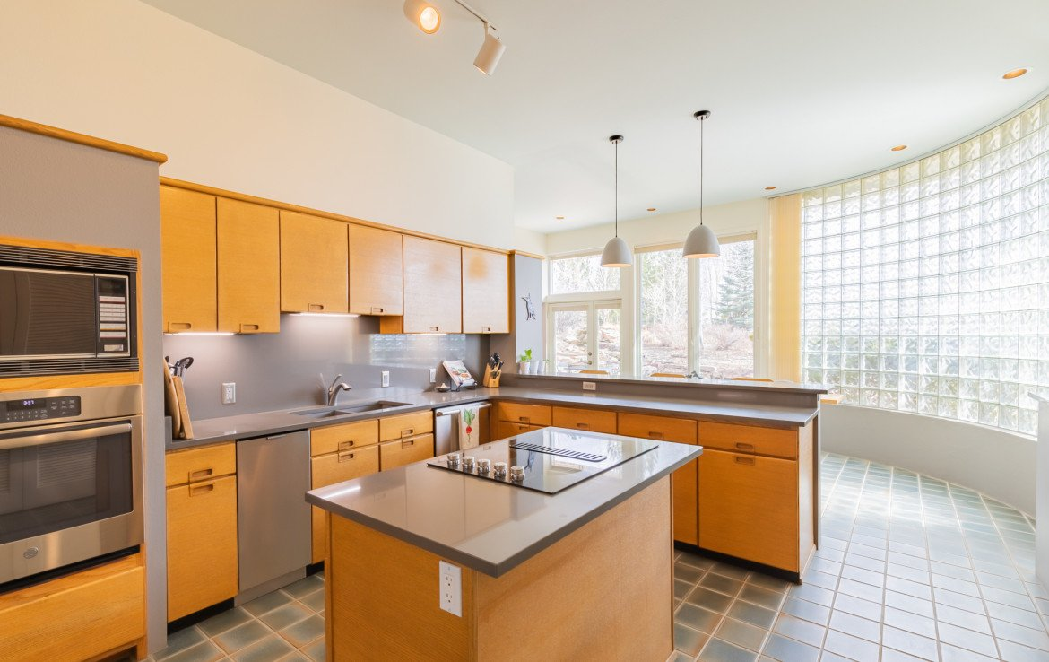 Kitchen with Center Island - 1690 Solar Ct Montrose, CO 81401 - Atha Team Residential Real Estate
