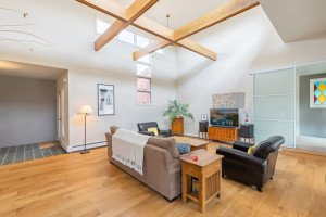 Living Room with Open Beams - 1690 Solar Ct Montrose, CO 81401 - Atha Team Residential Real Estate