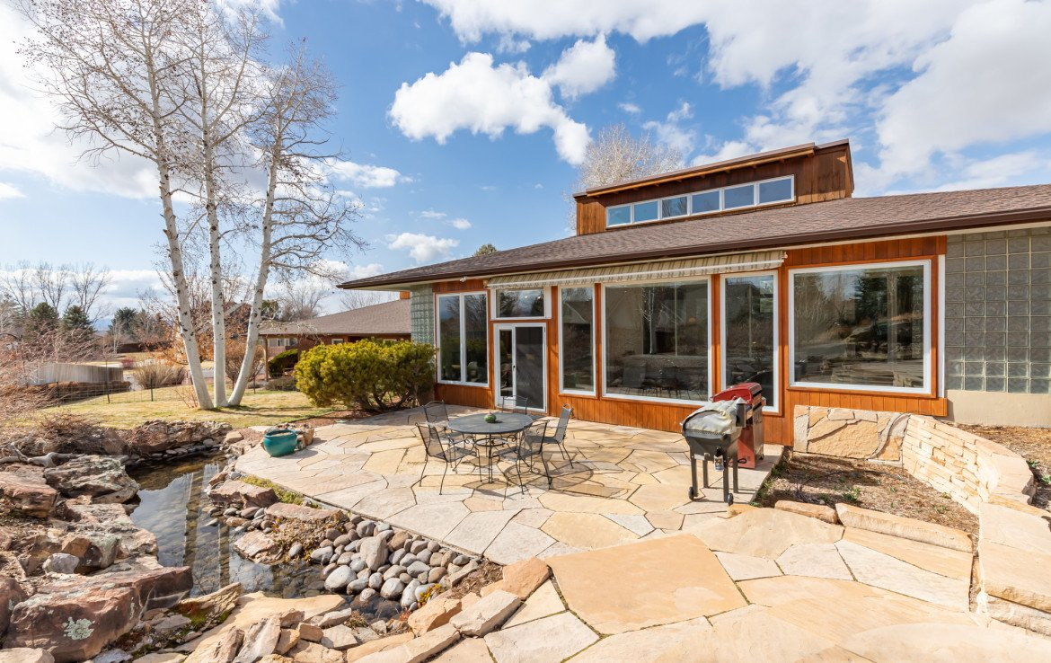 Flagstone Patio with Water Feature - 1690 Solar Ct Montrose, CO 81401 - Atha Team Residential Real Estate