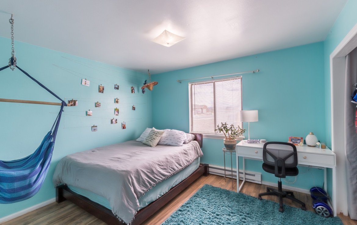 Bedroom with Laminate Flooring - 1639 6422 Rd Montrose, CO - Atha Team Real Estate Listing