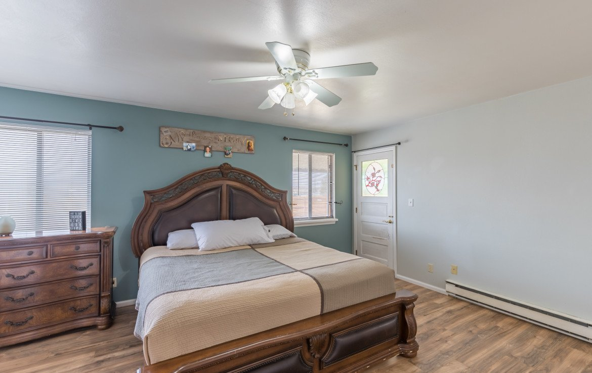 Master Bedroom with Back Yard Access - 1639 6422 Rd Montrose, CO - Atha Team Real Estate Listing