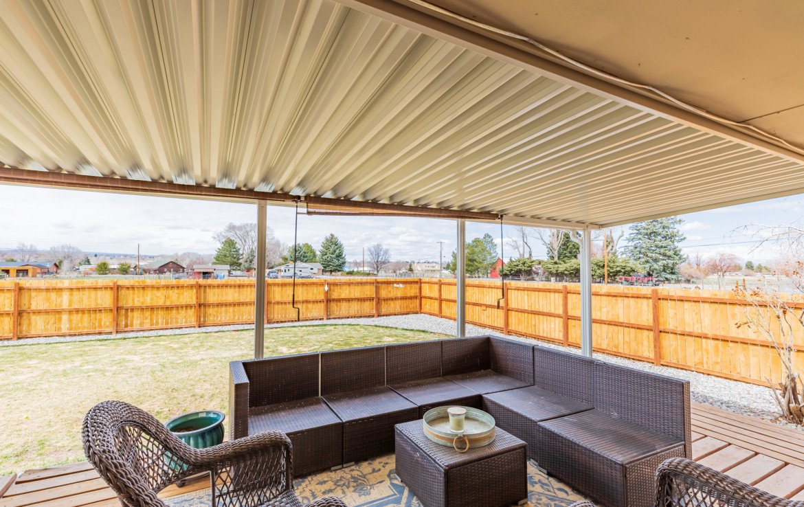Back Porch Covered Seating Area - 1639 6422 Rd Montrose, CO - Atha Team Real Estate Listing