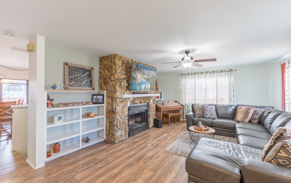 Living Room with Laminate Flooring - 1639 6422 Rd Montrose, CO - Atha Team Real Estate Listing