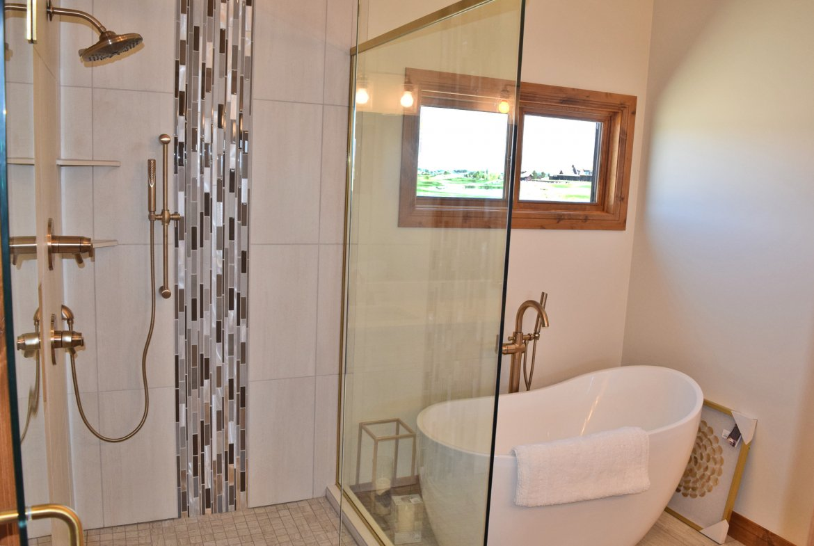 Bathroom with Tub and Tiled Shower - Lot-1935-Sleeping-Bear-Rd - Atha Team Residential Real Estate