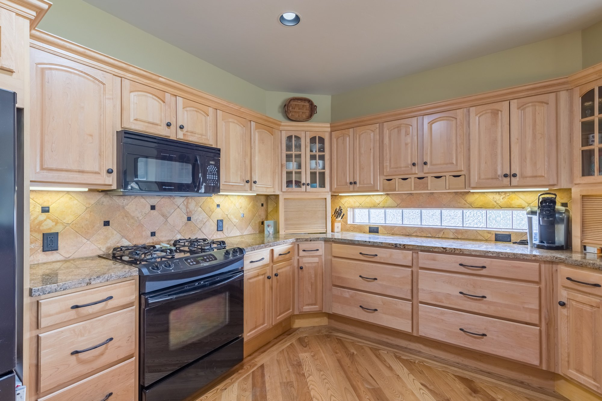 Kitchen with Appliances - 640 Badger Court Montrose, CO 81403 - Atha Team Real Estate Agents