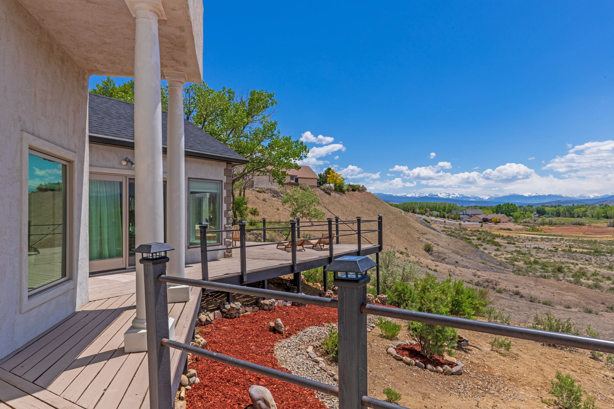 Back Deck with Landscaping - 16955 Wildwood Dr. Montrose, CO 81403 - Atha Team Luxury Real Estate
