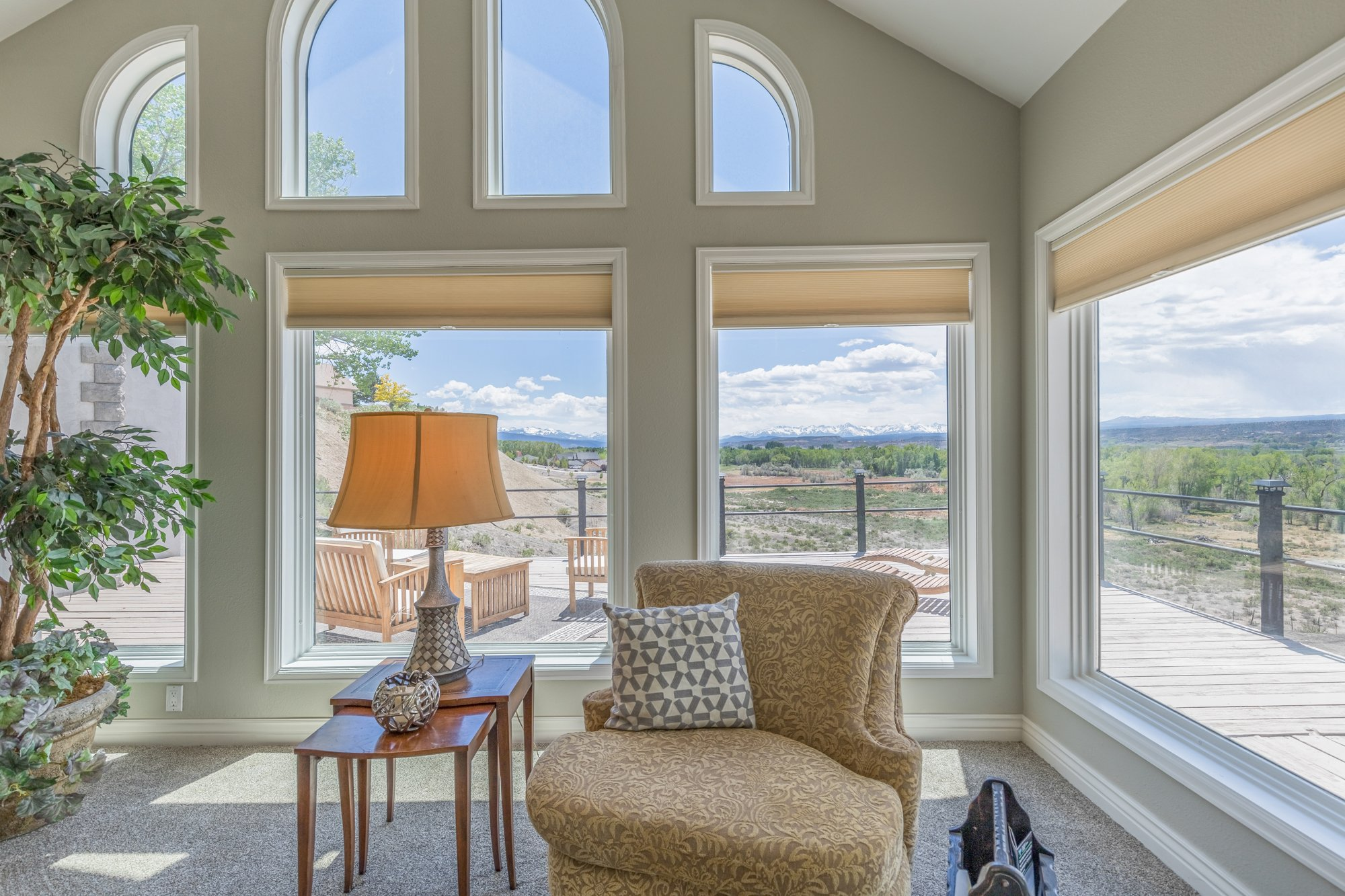 Living Room Mountain Views - 16955 Wildwood Dr. Montrose, CO 81403 - Atha Team Luxury Real Estate