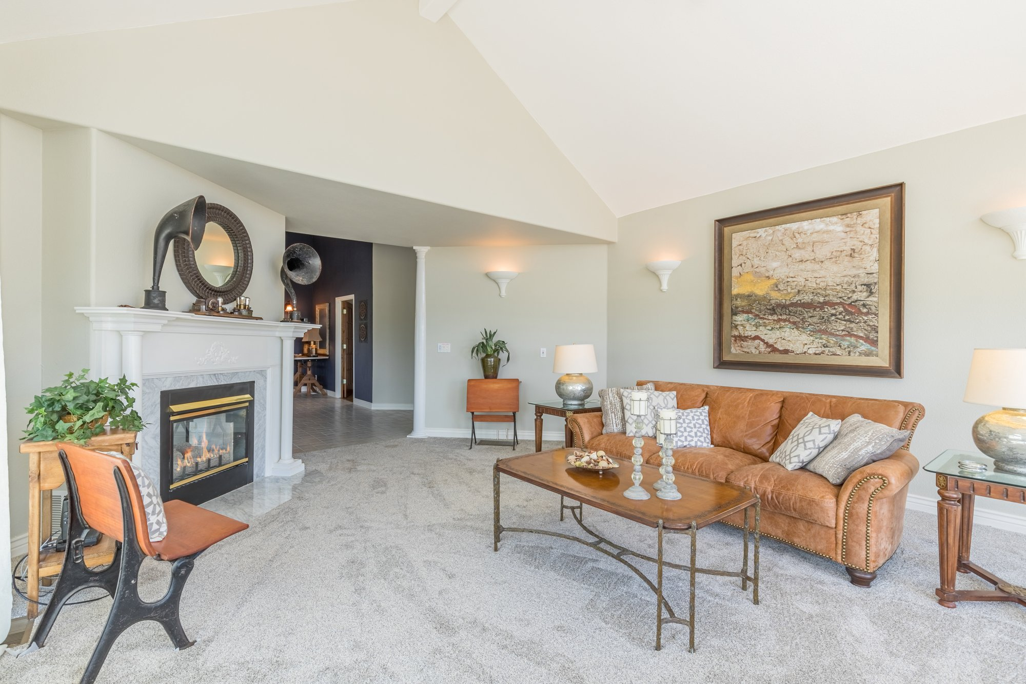 Living Room with Pass Through Gas FIreplace - 16955 Wildwood Dr. Montrose, CO 81403 - Atha Team Luxury Real Estate