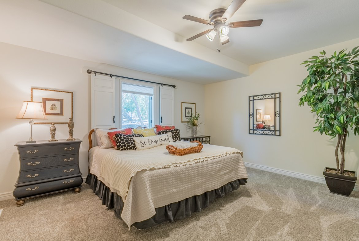 Bedroom with Barn Door Shutters - 16955 Wildwood Dr. Montrose, CO 81403 - Atha Team Luxury Real Estate