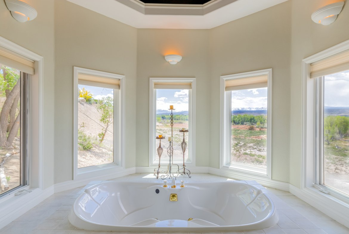 Master Bathroom with Jetted Tub and Views - 16955 Wildwood Dr. Montrose, CO 81403 - Atha Team Luxury Real Estate