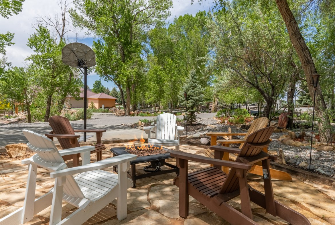 Outdoor Firepit and Seating Area - 16955 Wildwood Dr. Montrose, CO 81403 - Atha Team Luxury Real Estate