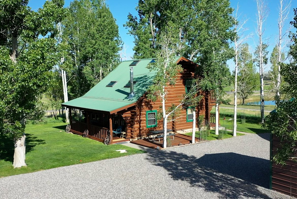 Log Home with Private Gravel Driveway - 21770 Uncompahgre Rd Montrose, CO 81403 - Atha Team Country Real Estate