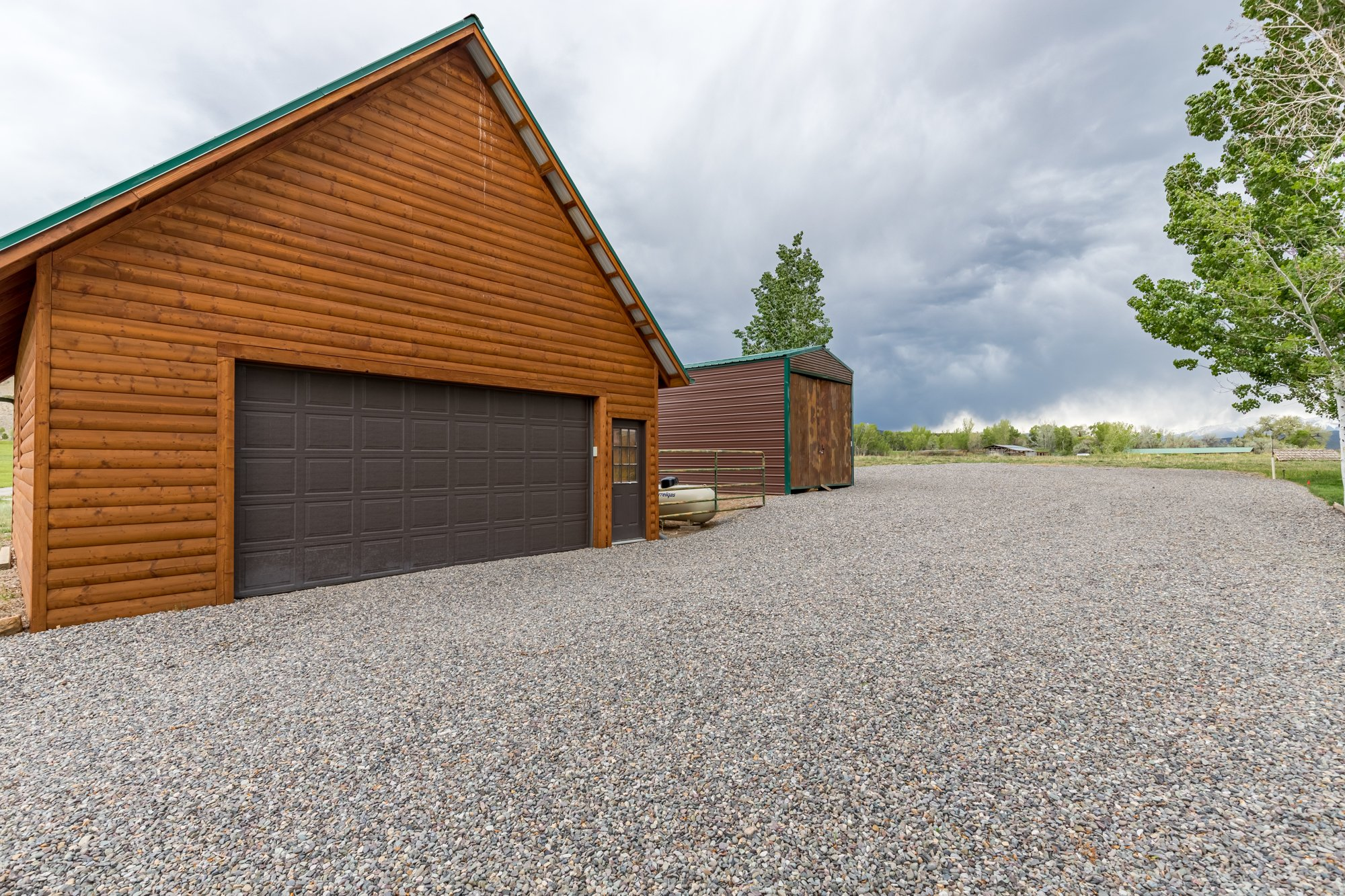 Detached Garage with Metal Workshop - 21770 Uncompahgre Rd Montrose, CO 81403 - Atha Team Country Real Estate