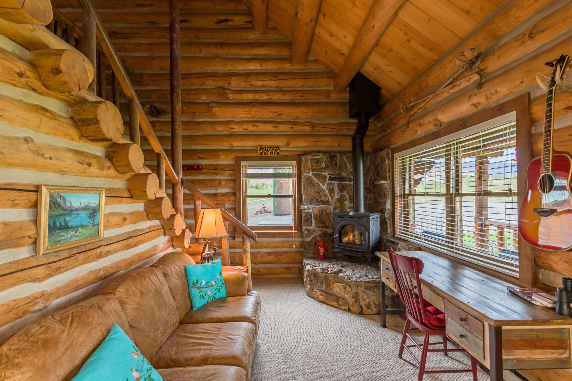 Living Room with Fireplace - 21770 Uncompahgre Rd Montrose, CO 81403 - Atha Team Country Real Estate