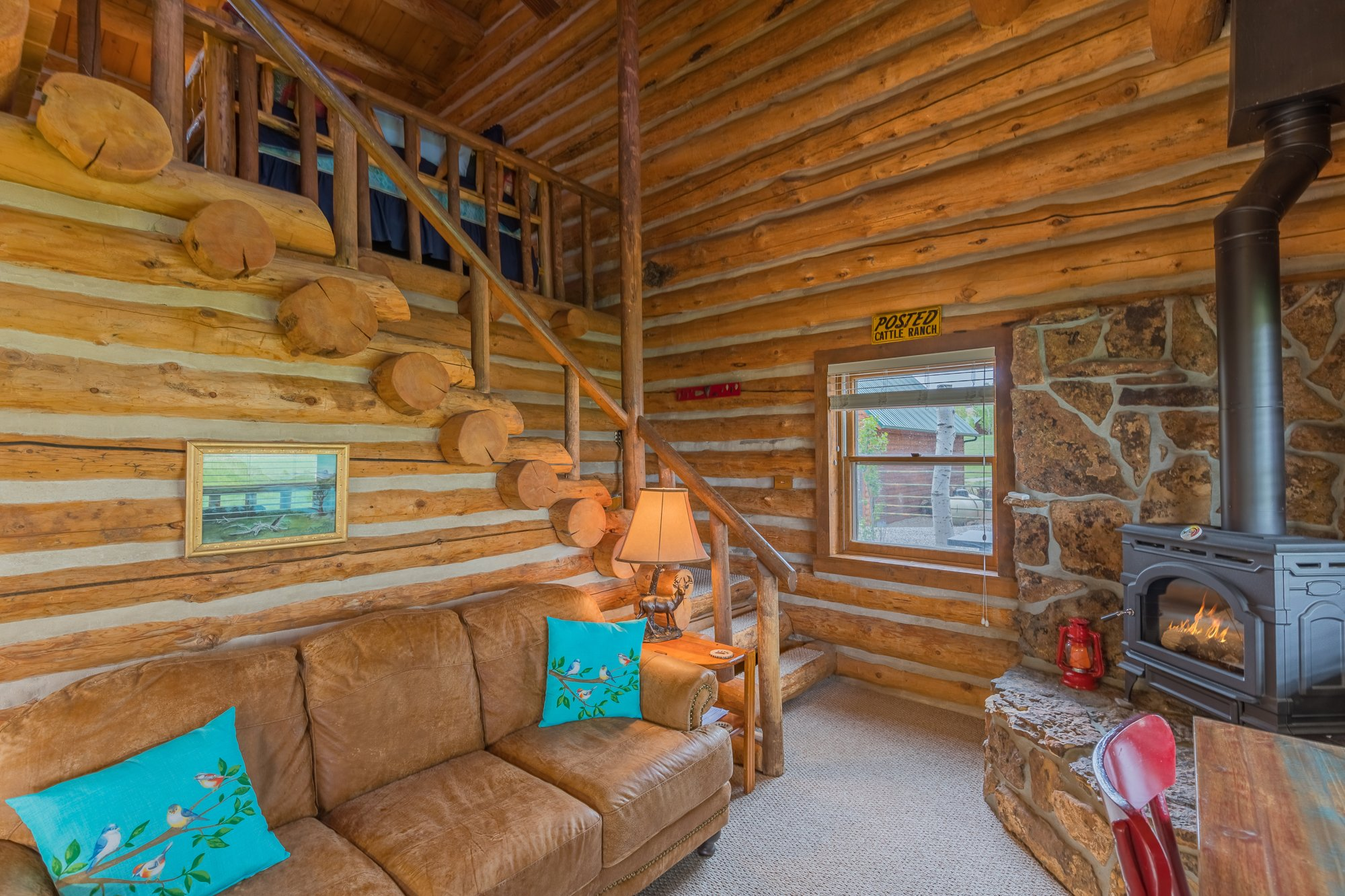 Living Room with Upstairs Access - 21770 Uncompahgre Rd Montrose, CO 81403 - Atha Team Country Real Estate