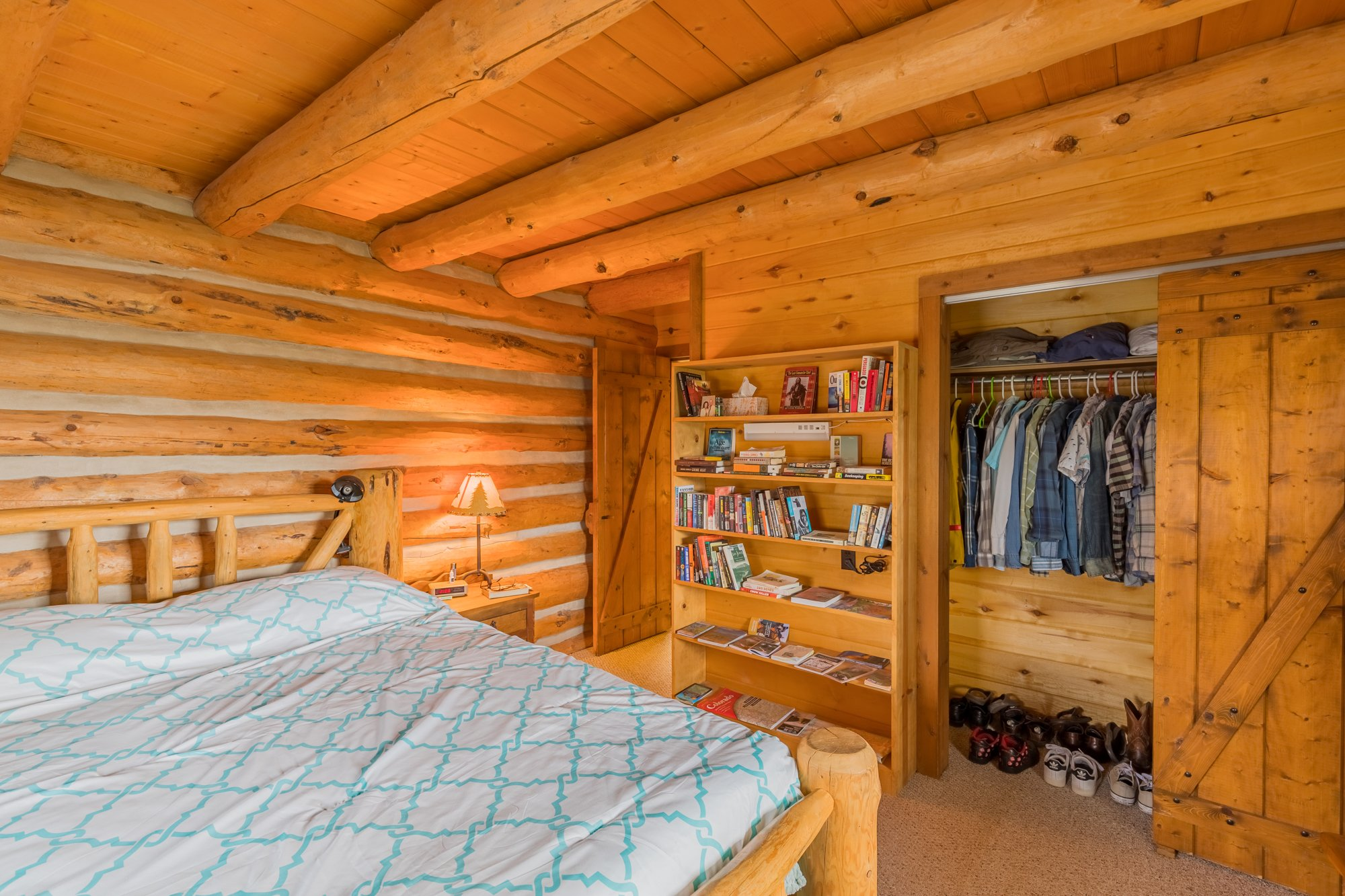 Bedroom with Closet - 21770 Uncompahgre Rd Montrose, CO 81403 - Atha Team Country Real Estate