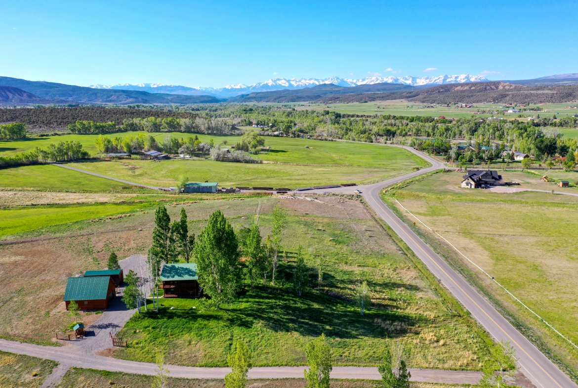 Aerial View of Log Cabin and Garage - 21770 Uncompahgre Rd Montrose, CO 81403 - Atha Team Country Real Estate
