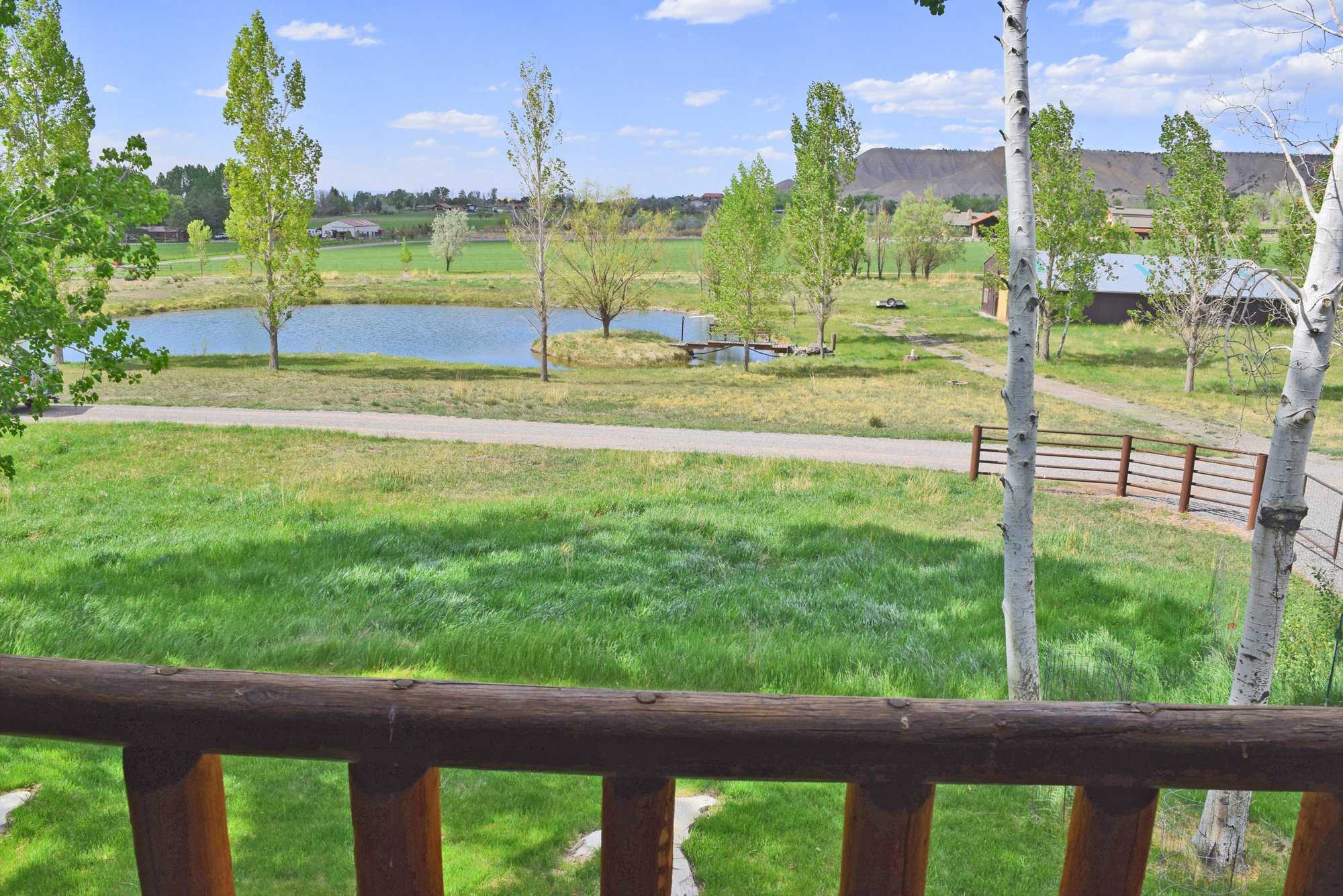 Pond Views from The Porch - 21770 Uncompahgre Rd Montrose, CO 81403 - Atha Team Country Real Estate