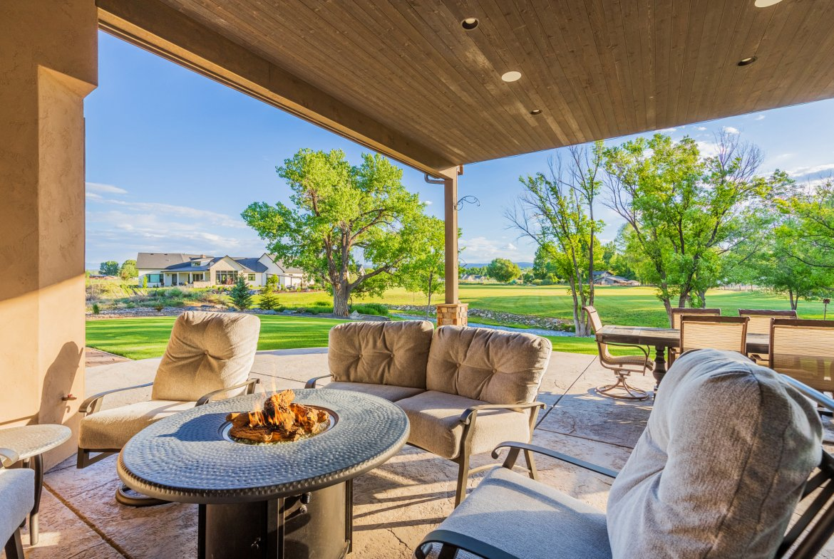 Covered Back Patio with Firepit - 15067 6140 Ln Montrose, CO 81403 - Atha Team Luxury Real Estate