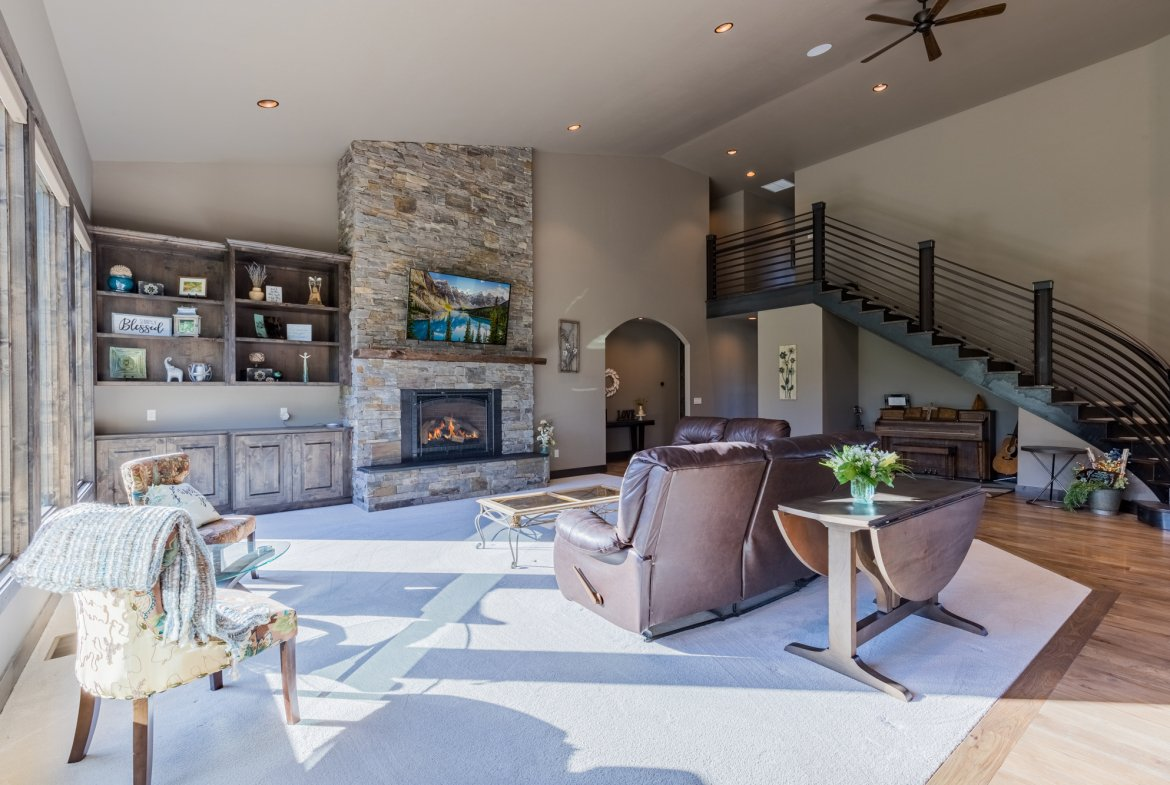 Living Room with Gas Log Fireplace - 15067 6140 Ln Montrose, CO 81403 - Atha Team Luxury Real Estate