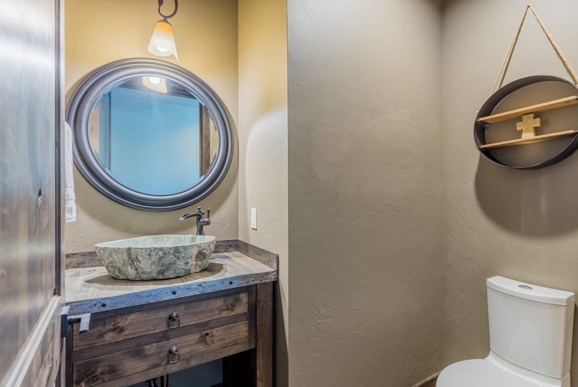 Guest Bath with Stone Sink - 15067 6140 Ln Montrose, CO 81403 - Atha Team Luxury Real Estate