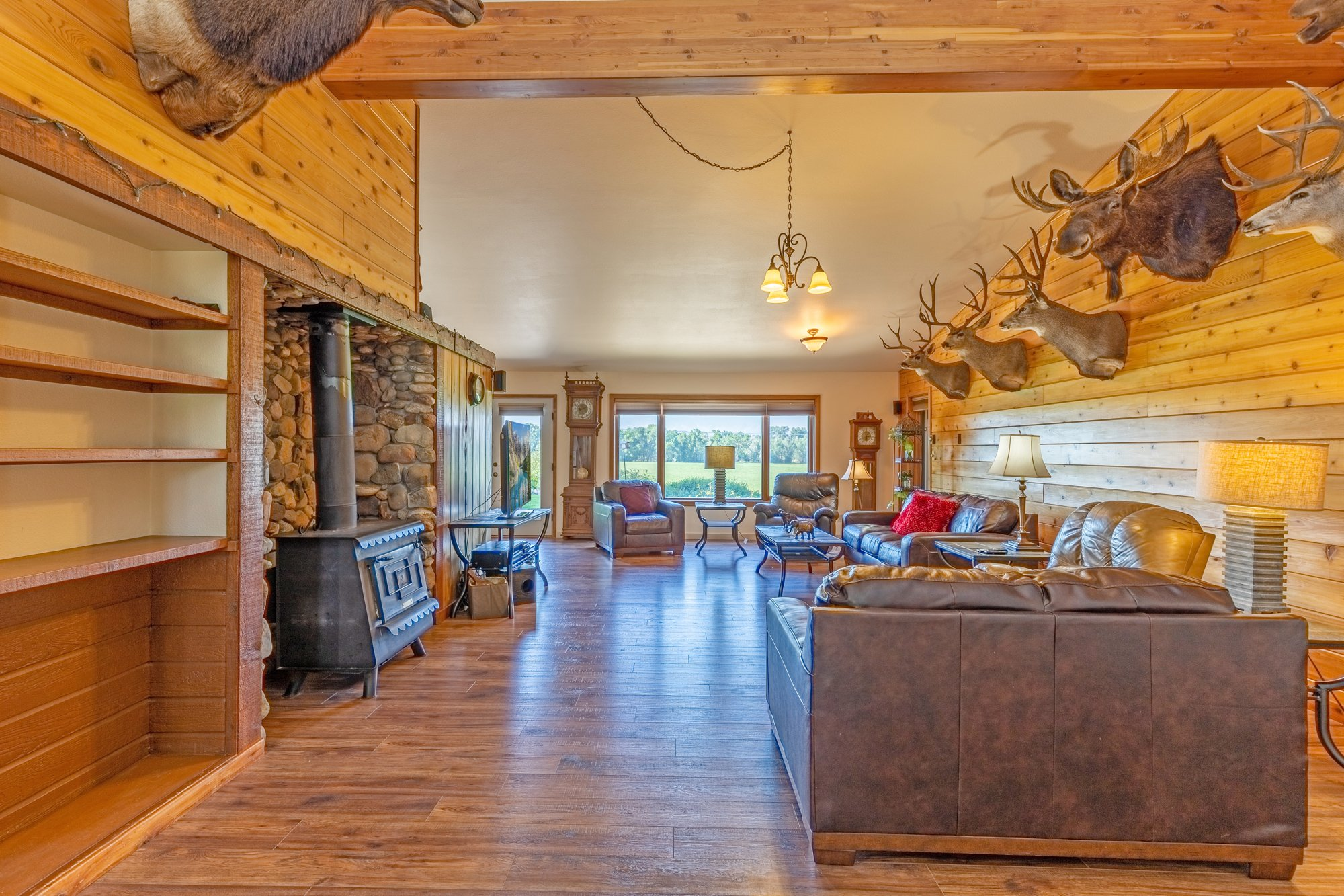 Living Room with Vaulted Ceiling - 17777 6650 Rd Montrose, CO 81403 - Atha Team Country Real Estate