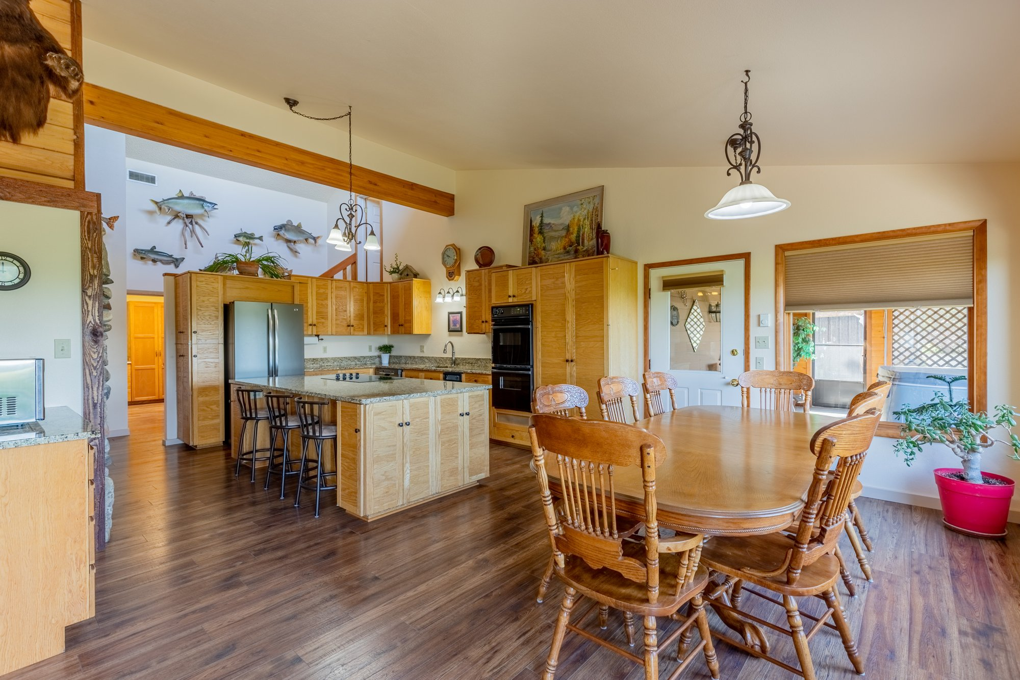 Open Kitchen and Dining - 17777 6650 Rd Montrose, CO 81403 - Atha Team Country Real Estate