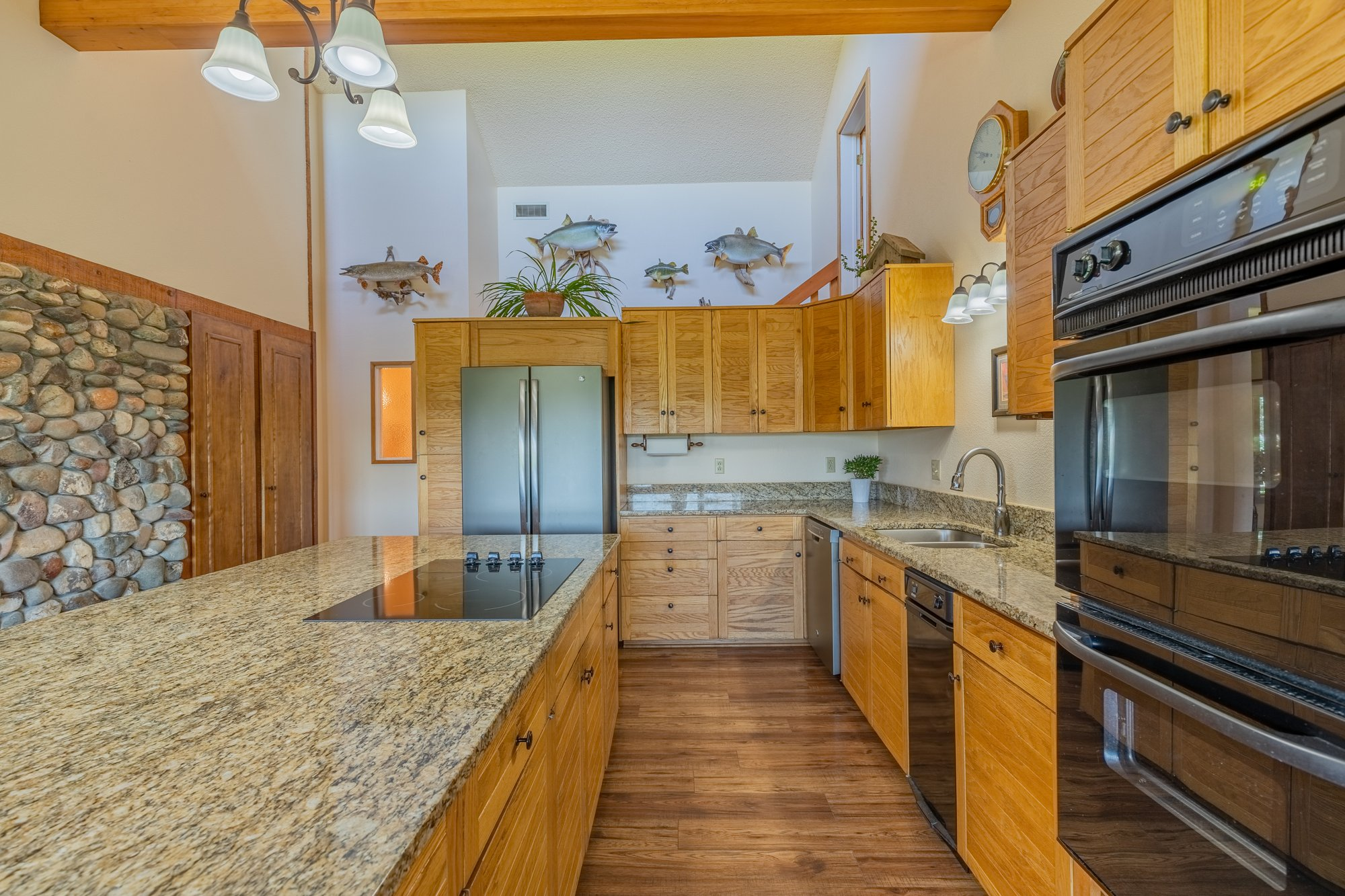 Kitchen with Granite Counter Tops - 17777 6650 Rd Montrose, CO 81403 - Atha Team Country Real Estate