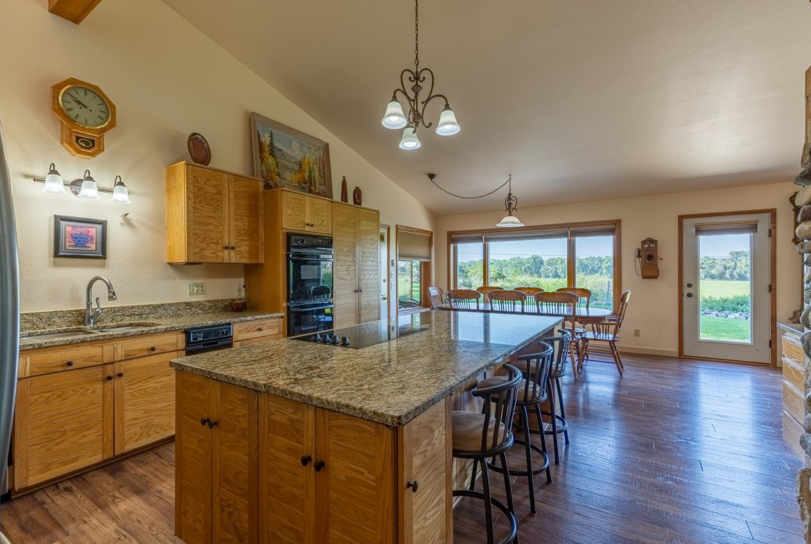Kitchen with Island Seating - 17777 6650 Rd Montrose, CO 81403 - Atha Team Country Real Estate