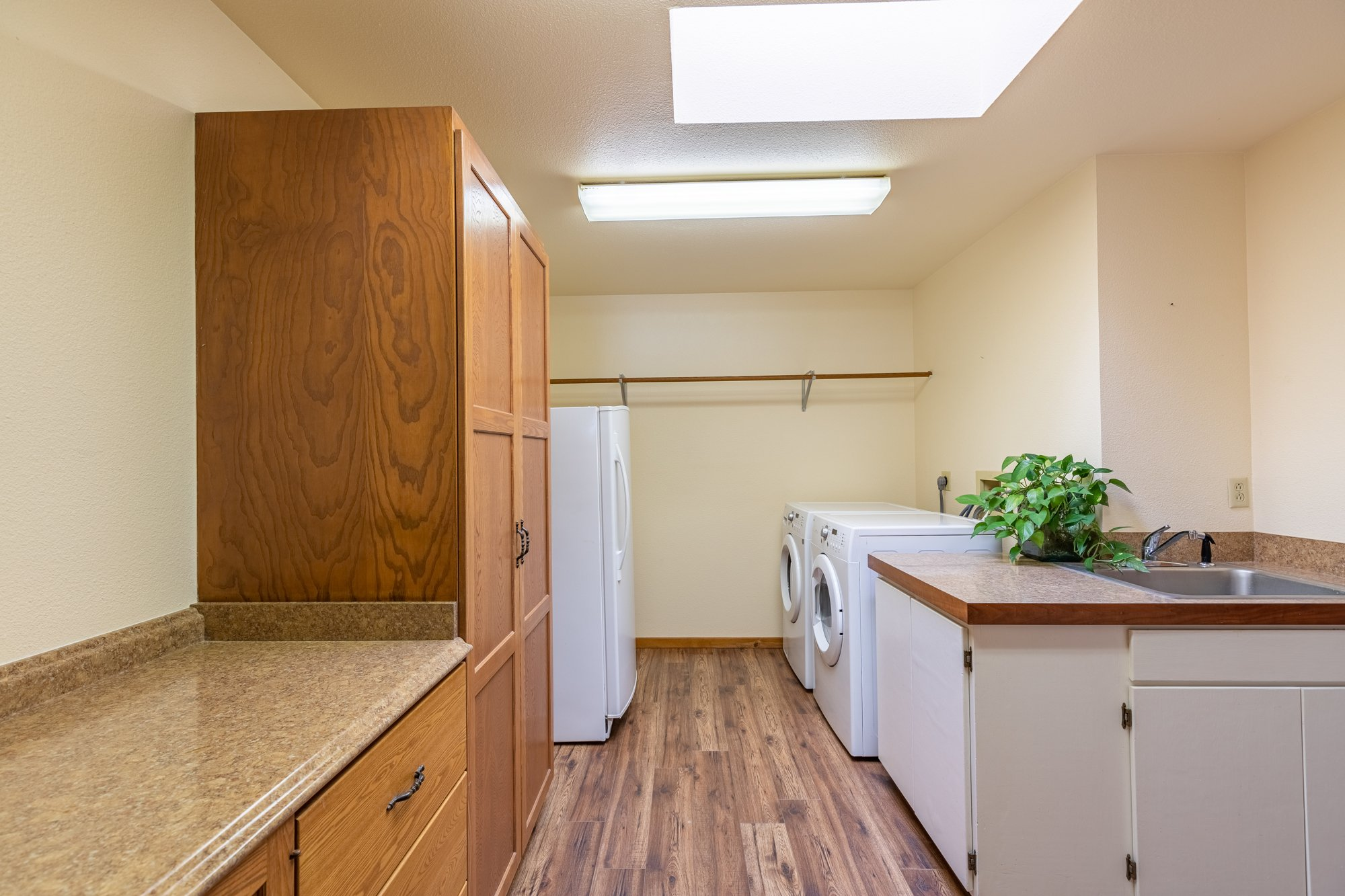 Laundry Room with Storage - 17777 6650 Rd Montrose, CO 81403 - Atha Team Country Real Estate