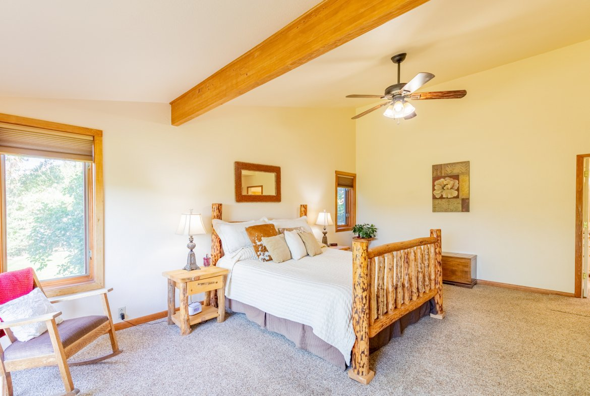 Master Bedroom with Ceiling Fan - 17777 6650 Rd Montrose, CO 81403 - Atha Team Country Real Estate
