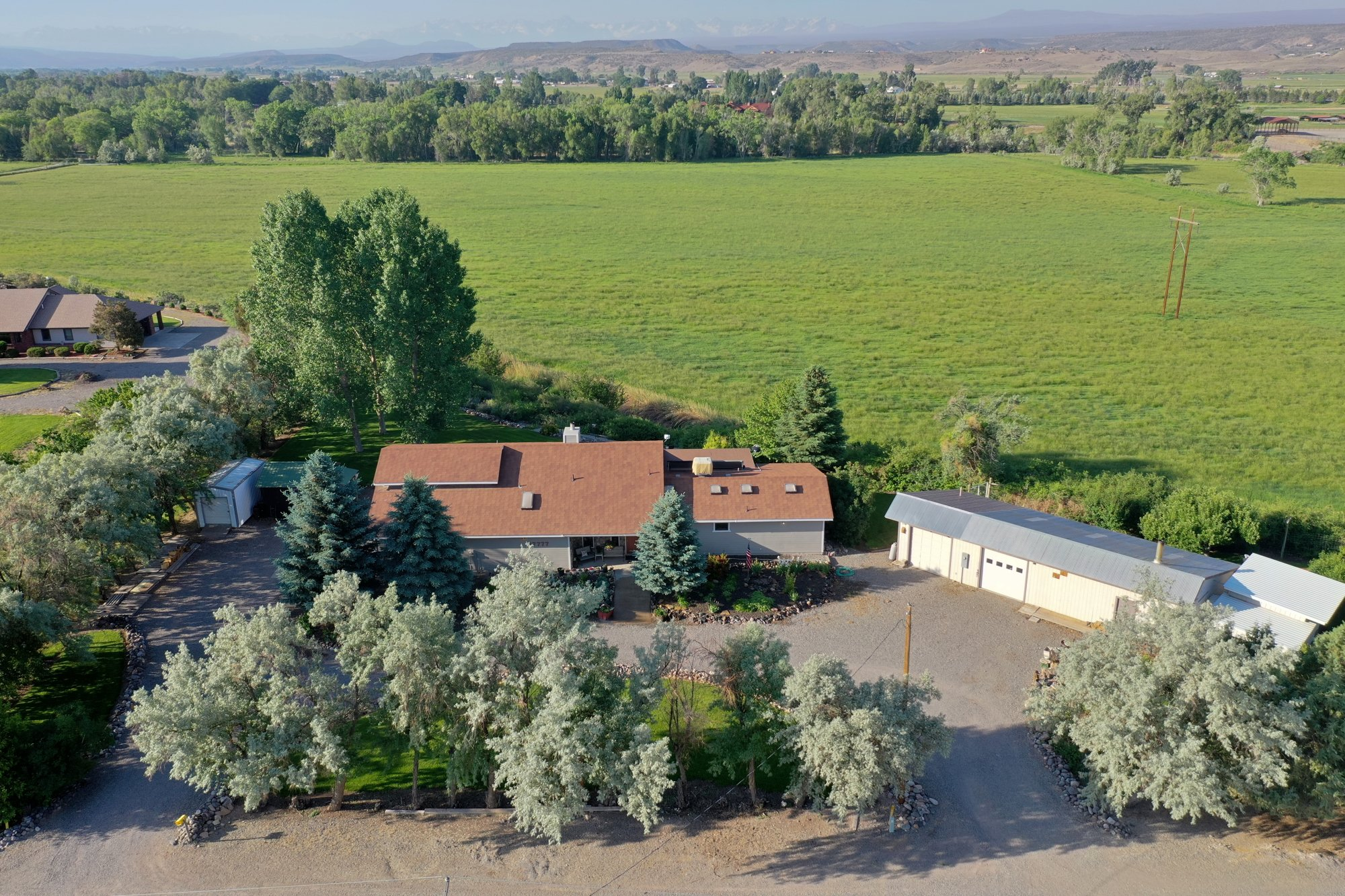 Aerial View of Home and Outbuildings - 17777 6650 Rd Montrose, CO 81403 - Atha Team Country Real Estate