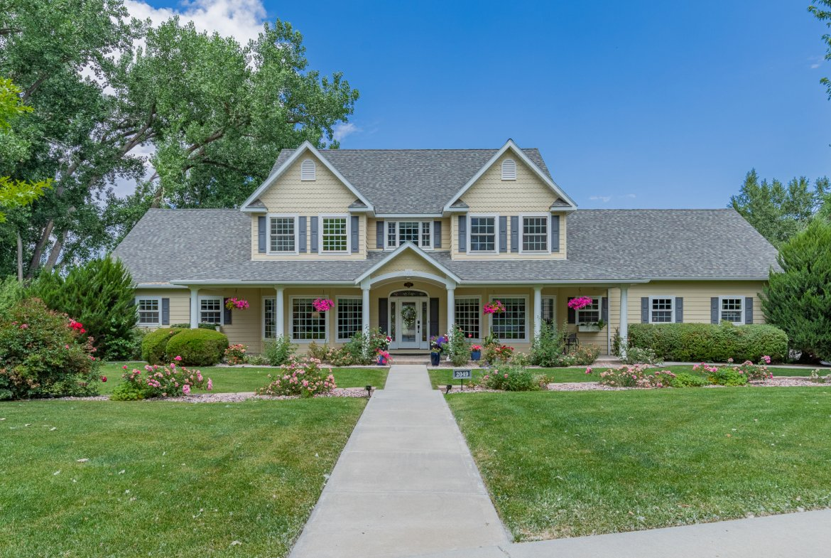 Front of Home with Landscaping and Walkway - 2049 Brook Way Montrose, Co 81403 - Atha Team Luxury Real Estate